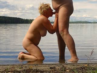 Granny\'s blowjob show to strangers on a sandy beach
