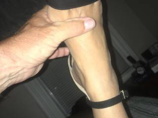 My wife likes to wear what turns me on. She put on these ankle strap heels and a thong. She has sexy feet and a great ass.