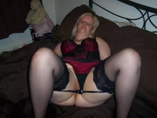 thighs open and wearing stockings ,,,here i cum ,,,