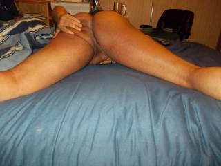 Spread on the bed ready to give up some ass and head.