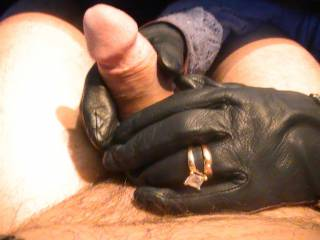 My mil giving me a leather gloved handjob