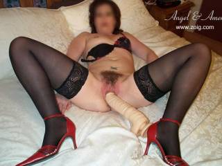 """Ooohhhh, I love how """"BIG"""" this """"DILDO"""" is!...  Teasing my """"CUNT LIPS"""" and """"LOCKED WITH MY HEEL""""!...  YUMM!"""