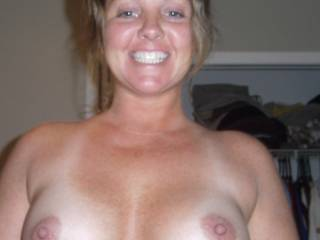 I think they're both lovely.. what a great smile! and what great, big, round tits and PERFECT, suckable big nips...mmmmmmmmmm