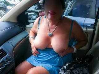 Flashing my tits in the car in a parking lot.