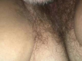 Her pussy is very wet wanting a dick to slide right in.  She has a bush at time but really a great feeling pussy and taste so good