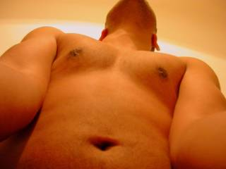 As his taut arms hold me up by my thighs, I love looking up his rigid and pumping torso, and I love listening to his balls rhythmically slap up against my ass ... and of course I love feeling him deep, deep inside!