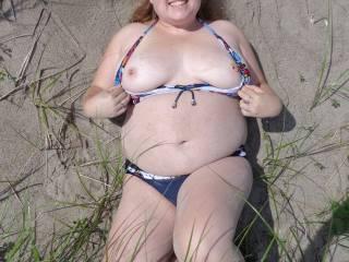 naughty peek a boo at the beach