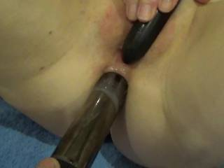 love to suck on her clit while both her holes get filled,then pull the toy out of that sex asshole and slide my cock in her while i fuck her ass i will pound that pussy with a toy,mmm