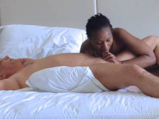 Interracial porn action with porn actress Ana Loxx and porn actor Cane performing in a blowjob session