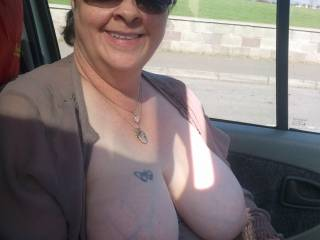 Your smile is awesome , good thing I am not driving near you , I would definately drive off the road being fixed on that gorgeous view of your tits