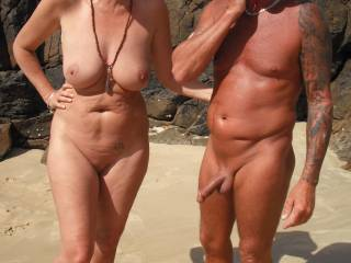 Me at our local nude beach and our nudist friend with the lovely cock.