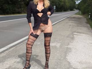 flashing on the road side .. Do you like my legs?