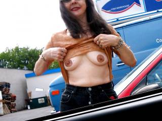 I was walking out to the car from the seafood market, and Mark yelled for me to flash my tits, so I did. There were several men in the parking lot who gave me a lot of hoots and whistles. What would you do if you saw me like this?