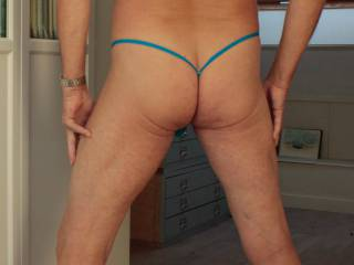 My angel loves my ass in a thong. So she took this picture of me wearing the absolute nothing. I think my ass is not in the bad shape I thought it was. I seldom see it myself. What is your opinion?