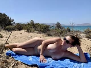 Posing nude near the beach