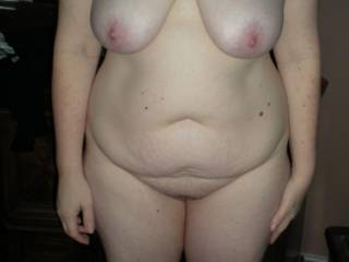 I seen My wife standing there and looking Hot so I Snapped off this pic of her sexy body.
