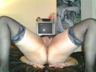 very sexy and love the stockings, just wish my face was buried in that juicy smooth pussy
