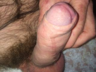 I see some precum dripping... imagine my soft lips on the tip, kissing it softly, tasting your manhood...