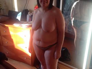 What a gorgeous body, beautiful big tits too, I like the view of your sexy ass in panties in the mirror, but if you want to take off your panties that sounds good to me, just wish I was there to help you.