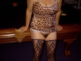 My wife dressed for a night of COUGARing, showing her black bush.