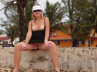 Another photo of me in the bahamas showing off my tits and pussy. The locals were playing basketball right behind me. Boy did they miss a show!