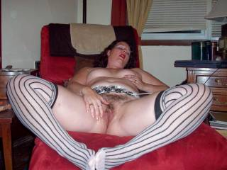 Damn what a beautiful hairy pussy!! Love the stockings too!!