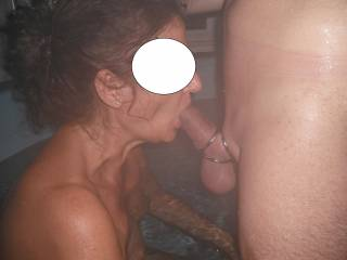 Sucking his lovely smooth thick cock in the spa at home. I love it when he wears his triple cock ring, it makes him extra hard.
