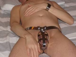 My long time (and now long distance) sub with his cock locked safely away in a chastity belt.