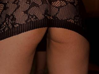 A close up of my ass, me bent over. The dress I wore when my parents came around last night for my birthday