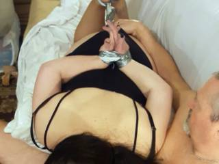 Wife in a hogtie position while sucking this guy off