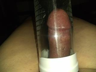 Playing with a penis pump.