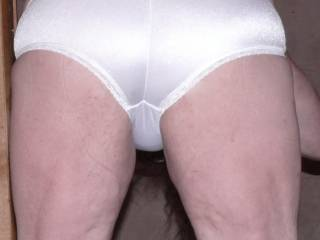 Those shiny panties beg more fingering than spanking but if you insist.