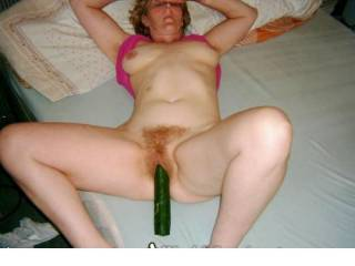 love to be pushing the cucumber into the tight red haired pussy