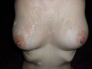 Cumming on her pierced tits after a handjob.