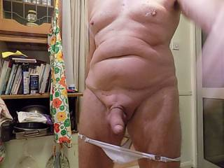 photo taken showing my cock after slipping down my white thong