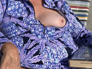 Her tit accidentally fell out as she flashes her pussy