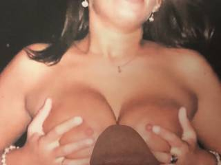 I'd love to enjoy navycunt's voluptuous breasts squeezing my cock as she smiles 🥃at me like this😉
