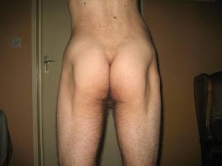 Squeezing my ass.