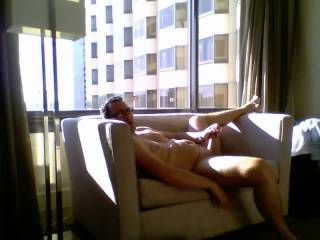 Video of hubby webcamming with me when he was on a trip and letting hotel neighbors watch him if they happen to see him.  Love the cumshot at the end.  He actually was with his coworker on this trip but that video will be uploaded next of him fucking her.