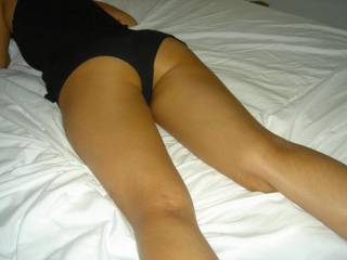 My cock would start to get hard just like it is now... so I'd probably give those delicious little cheeks a gentle squeeze, slide her panties off, and lick her ass and pussy from behind... And of course, I'd have to slide my cock into her..