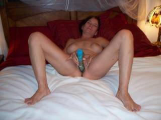 Kathy begins to penetrate her tight opening with a thick, 10 inch cock shaped vibrator. This petite gal loves having her pussy stretched wide when she\'s fucking a hard cock. Tell her if you think you can stretch her pussy wide with your manhood.