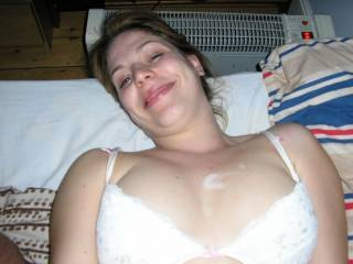 nice smile. that's what i would love to cover in cum, but tits are nice also