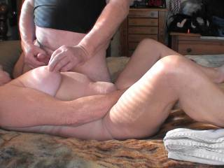 I have my wand vibrator between my legs while he is rubbing his cock on my one tit while tweaking my nipple on the other tit.  Does it look as good as it feels