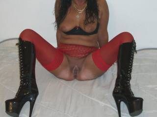 Your fucking hot and sexy in those boots and I want to shove my cock deep inside you while you wrap your legs around my back!
