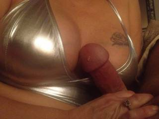 My hubby loves my titties in shiny lingerie ! I love to have him run his cock on them .