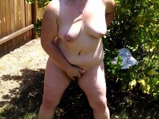 Another day of rubbing her pussy in the backyard.