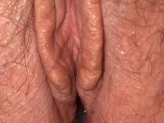 Wife's freshly fucked pussy. My load of cum is deep inside.