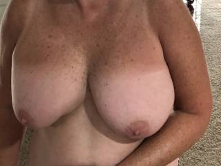 Showing off her sexy tits.
