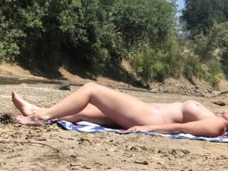 The warm sun feels so good on my tits!