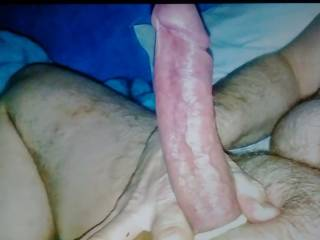 Stroking cock with a cockring